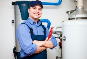 plumber-standing-beside-water-heater