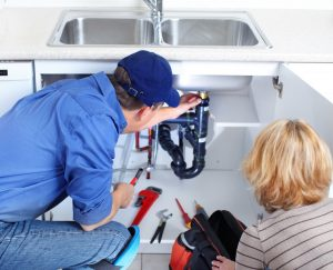 plumber-and-homeowner-inspecting-drain